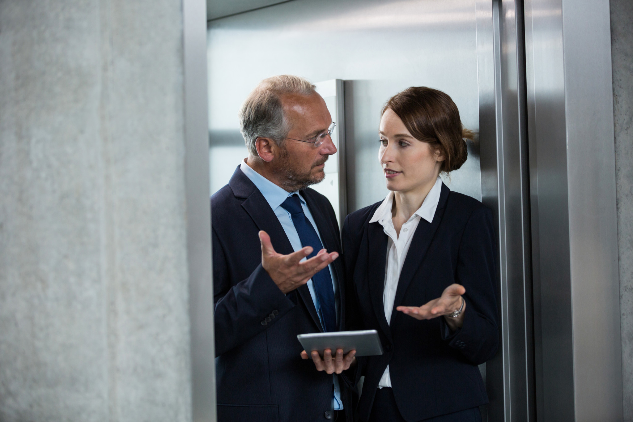 Businessman with colleague in an elevator